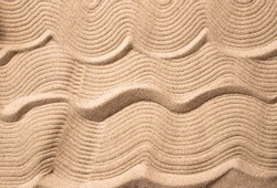Abstract background of sand. Abstract sand waves as a background. Copy space. Macro.