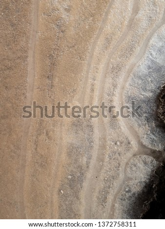 Abstract background of sand under ice. #1372758311