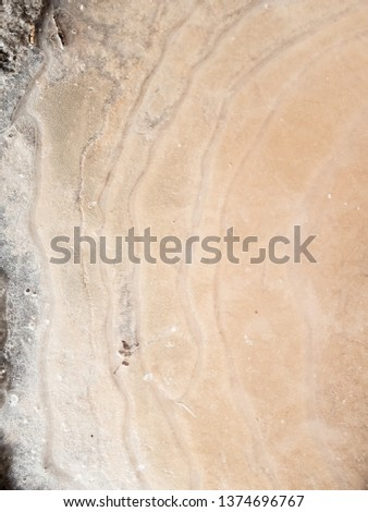 Abstract background of sand under ice. #1374696767