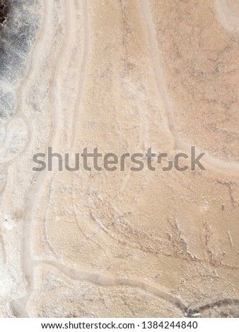 Abstract background of sand under ice. #1384244840