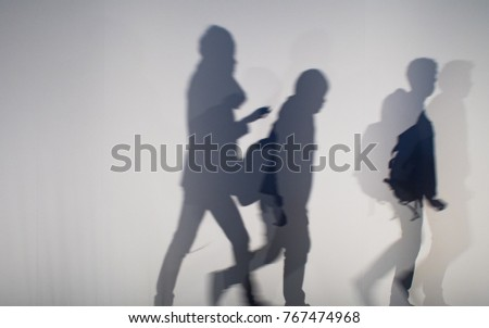 abstract background of shadows people on a white wall. #767474968