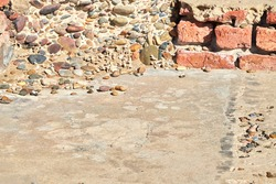 Abstract background of small cement and pebble floor and wall with bricks and pebbles pattern