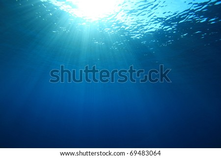 Abstract background of sunbeams in blue sea water #69483064
