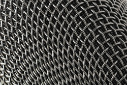 Abstract background of texture of the microphone. Pattern of the microphone. Podcast, radio, studio, recording background.