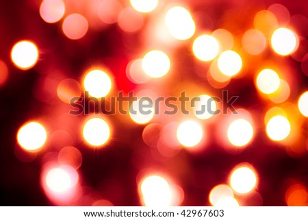 Abstract background of vivid round lights. Red tint