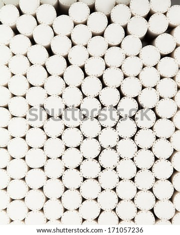 abstract background of white filters of cigarettes, closeup view
