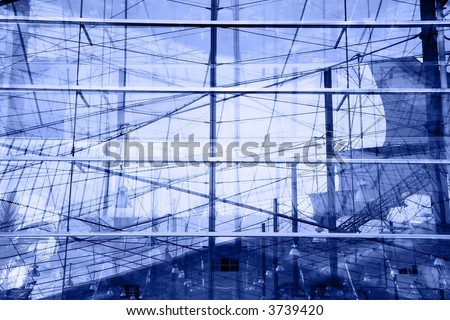 Abstract  background - overlapping reflections in the windows of a modern conference hall. Blue monochrome