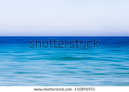 abstract background picture of the sea made by panning the camera