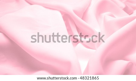 Abstract background pink silk fabric with waves. Shallow DOF