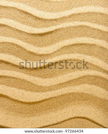 Abstract background. Pure golden sand. Wind and water have created a small dune.