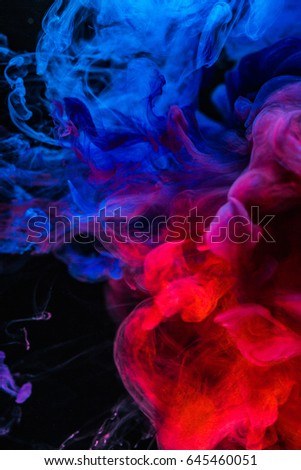 Abstract background, smoke texture in the air. Smoke fragments isolated on dark background. - Shutterstock ID 645460051