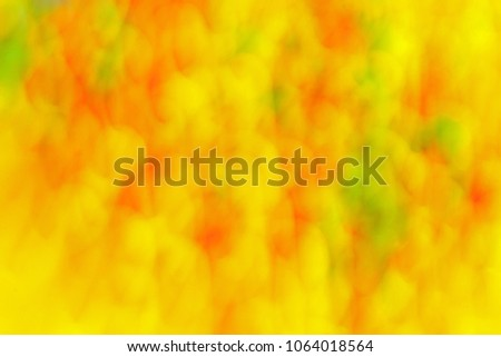 Abstract  background, spots and stains. Fantasy pattern in yellow, orange and green colors. Background with tie dye effect and streak effect. Directional blur, motion effect #1064018564