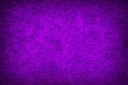 Abstract background texture image of plastered concrete wall, in purple tones with darker edges.