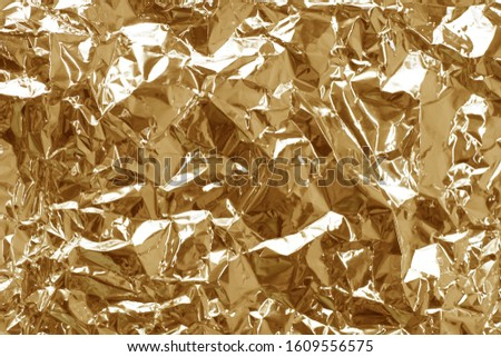 ABSTRACT BACKGROUND TEXTURE OF A FOIL, SHINE,SHINE
