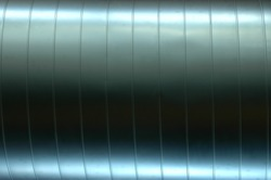 Abstract Background Texture of a Shiny Air Vent Pipe