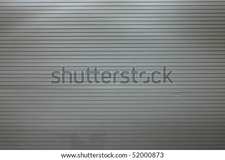 Abstract background texture of scuffed shop shutters