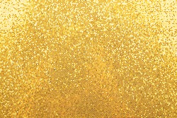 Abstract background texture of shiny golden glitter pattern light gradient