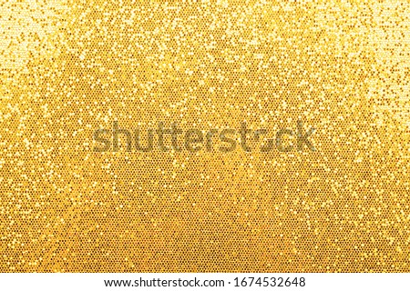 Photo of  Abstract background texture of shiny golden glitter pattern light gradient