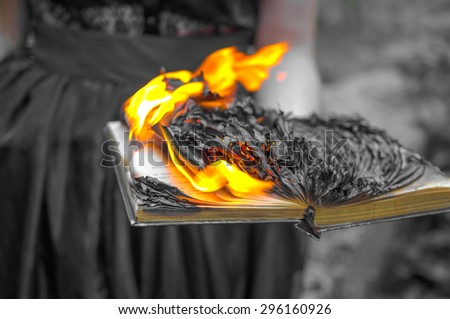 Abstract background - the burning book in women\'s hands