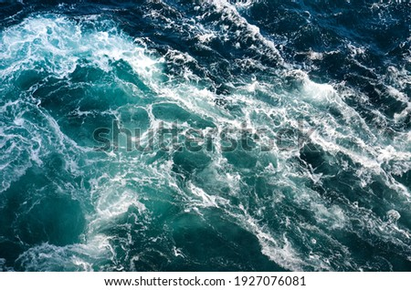 Abstract background. The waves of the sea water meet with underwater pointed rocks, forming whirlpools. Whirlpools in the area of the Norwegian city of Bod?. Norway Stock photo ©