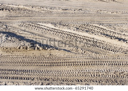 Abstract background - the wheel tracks in the sand.