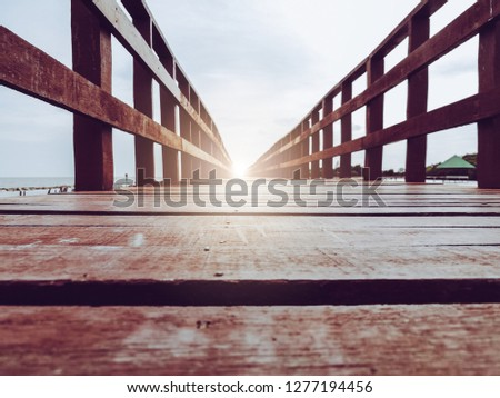 Abstract background walkway on wooden bridge with light at the end represent gateway of new happy life ending exit darkness entrance to freedom new journey of shine with success vision and wisdom #1277194456