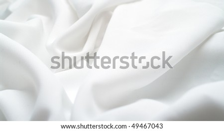 Abstract background white silk fabric with waves. Shallow DOF - stock photo