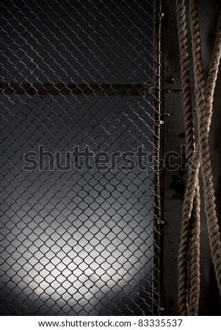 Abstract background with an old metal grid and a rope