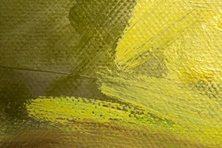 Abstract background with brown and yellow oil paint on canvas. Close-up of brushstrokes in the painting. Olive, ocher, lemon yellow paint. Handmade background design with canvas texture. Oil painting
