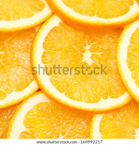 Abstract background with citrus fruit of orange slices. Close up.