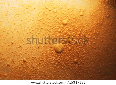Abstract background with golden oil in water.  #715317352