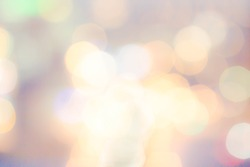 Abstract  background with natural Bokeh texture and defocused Sparkling sun lights. Vintage Pastel colorful background with twinkling lights