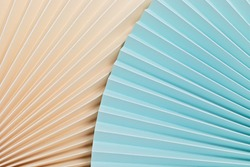 Abstract background with textured paper fans. Festive celebration backdrop. Mockup for product demonstration