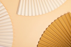 Abstract background with textured paper fans. Festive celebration backdrop. Mockup for product demonstration with copy space