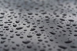 Abstract background with water drops on metal surface close up