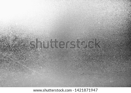 abstract backgrounds, characteristics of the light strikes the surface, causing noise and grain texture #1421871947