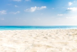 Abstract beach background. White sand, blue sky and calm tropical beach landscape. Exotic nature concept