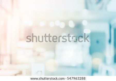 Abstract beautiful blur bokeh shop background. clean business mall lifestyle new counter bar concept for banner, mobile desktop wallpaper office solution: Idea light for insert create text and number.