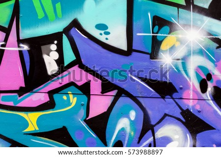 Abstract beautiful street art colorful graffiti style closeup. Detail of a  wall. Can be useful for backgrounds. Modern iconic urban culture  youth, concept design