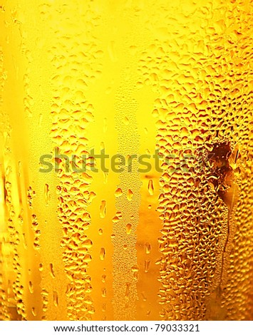 Abstract beer background with water drops
