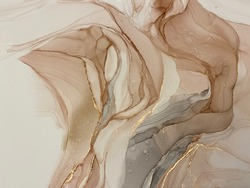 Abstract beige art with gold — pink background with brown, beautiful smudges and stains made with alcohol ink and golden pigment. Beige fluid art texture resembles petals, watercolor or aquarelle.
