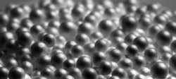Abstract black and white background. Black foam balls. Mysterious black objects, macro. Universe of foam balls.