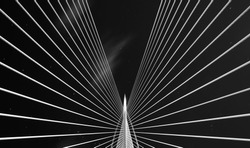 Abstract black and white bridge and sky .