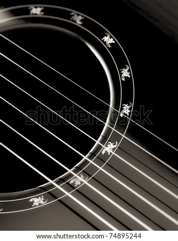 Abstract black and white image of a six string classical guitar.