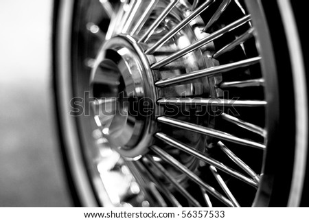 abstract black and white of vintage muscle car wheel chrome