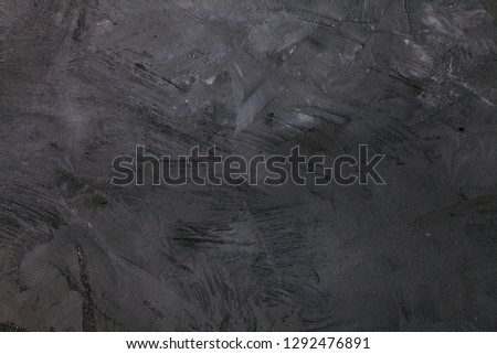 Abstract black background with rough distressed aged texture, grunge charcoal gray color background for vintage style cards or web backgrounds or brochure backdrop for ads or other graphic art images #1292476891