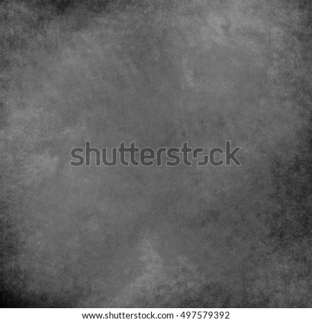 abstract black background with rough distressed aged texture, grunge charcoal gray color background for vintage style cards or web backgrounds or brochure backdrop for ads or other graphic art images #497579392