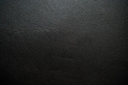 Abstract black genuine fullgrain leather background, Cowhid texture
