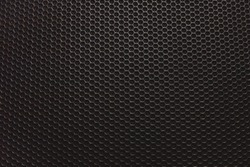 Abstract black metallic mesh texture pattern for background. Industrial backdrop. The speaker of a musical column. Free space for text.