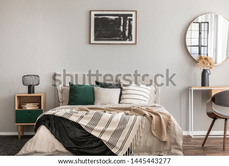 Abstract black oil painting in frame on empty beige wall of cozy bedroom #1445443277